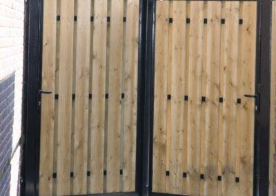 2 enkele draaipoorten met houtvulling aan beide zijden bekleed 1