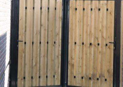 2 enkele draaipoorten met houtvulling aan beide zijden bekleed 2